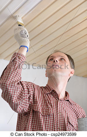 Stock Photographs of Varnishing a wooden ceiling.