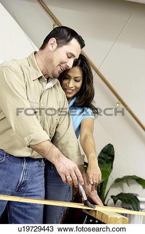 Stock Photo of Couple varnishing wood u19729443.