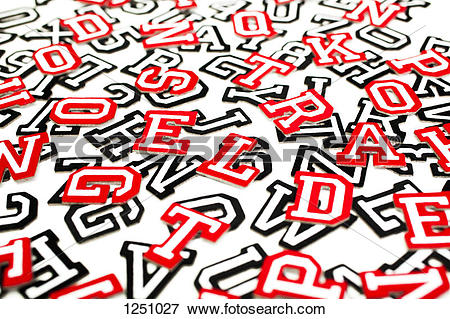 Picture of A bunch of varsity font sticker letters and numbers in.