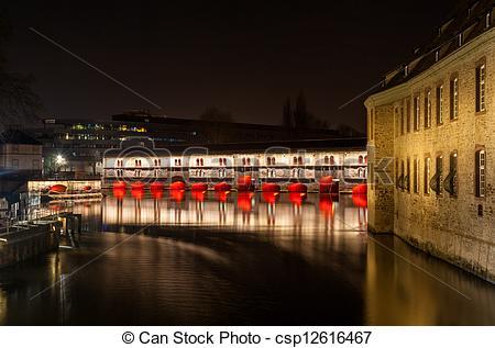 Stock Image of Night illumination of Barrage Vauban (Vauban weir.