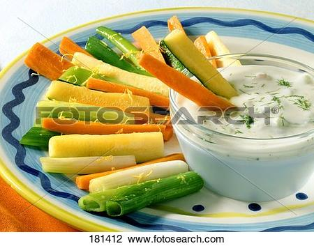Stock Photo of Braised vegetable sticks with yoghurt and walnut.