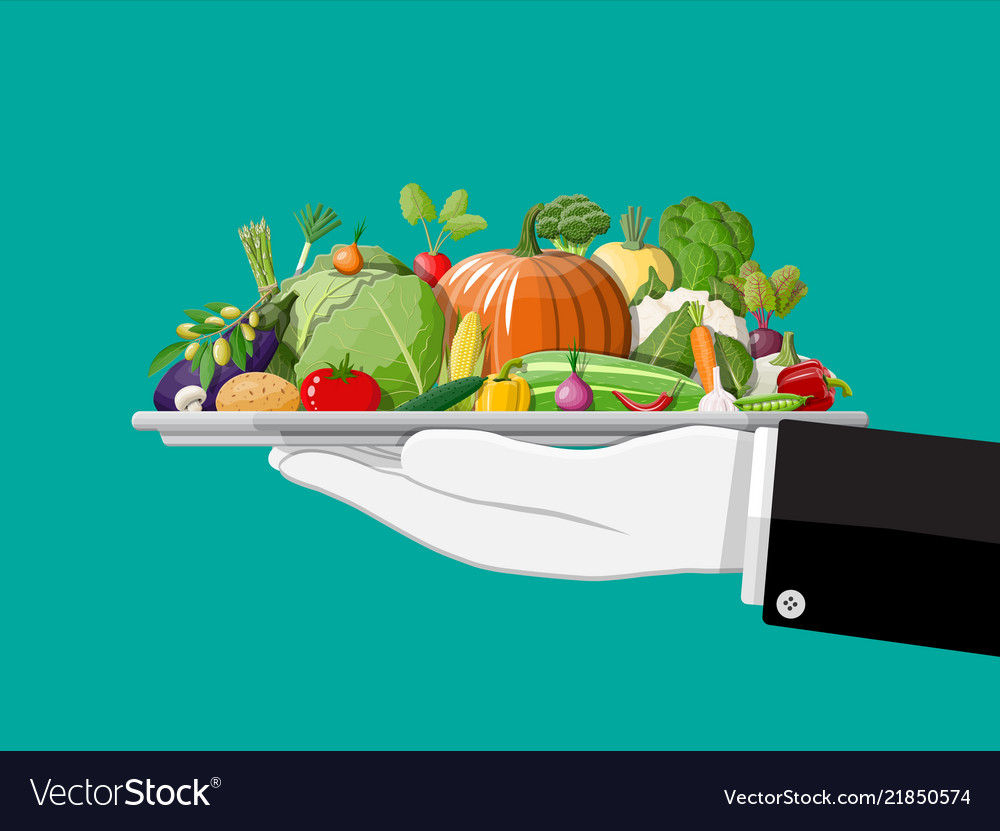 Tray full of vegetables in hand.