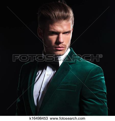 Stock Photo of serious face of a young man wearing green velvet.