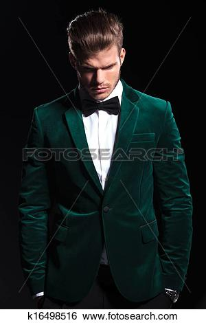 Stock Images of man in a green velvet suit is looking down.