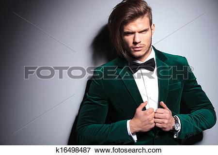 Picture of angry young man in green velvet suit k16498487.