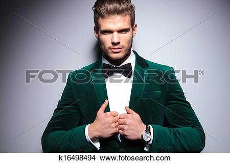 Stock Photo of smiling young man in an elegant velvet suit.