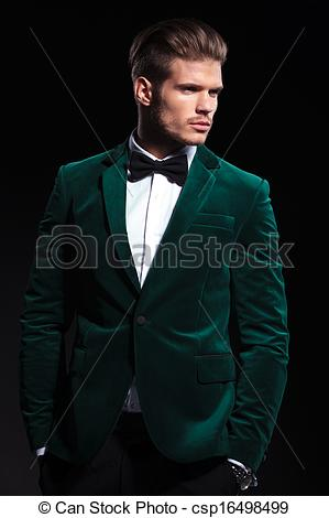Stock Photographs of side view of a young elegant man in green.