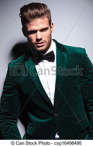 Stock Photographs of happy young man wearing a green velvet suit.
