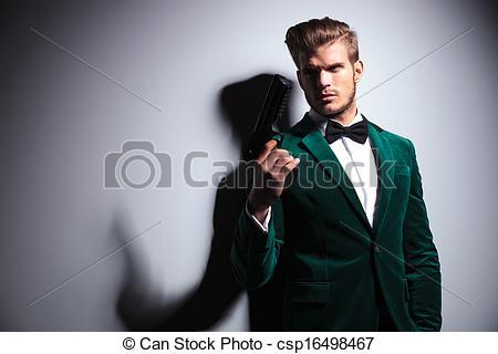 Stock Image of man in elegant green velvet suit holding a big gun.