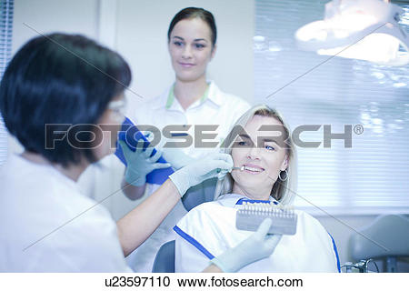Stock Photography of Dentist testing veneers on patient u23597110.