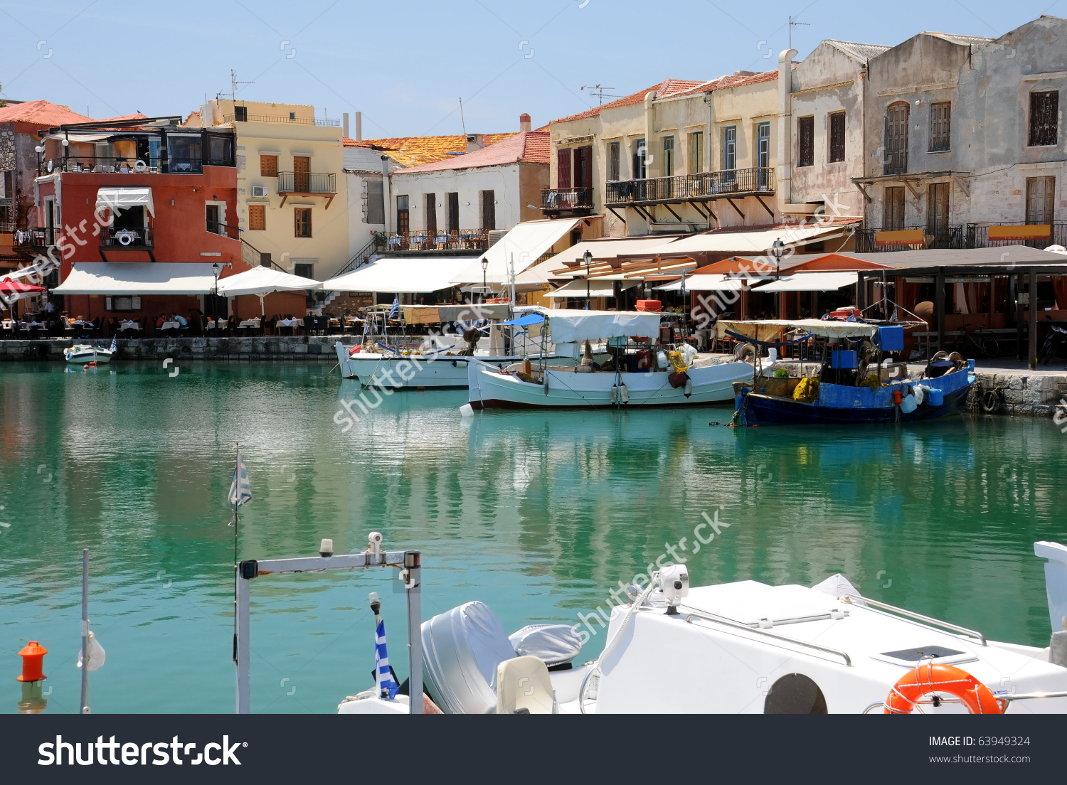 Boats And Restaurants In The Old Venetian Port Of Rethymno On.