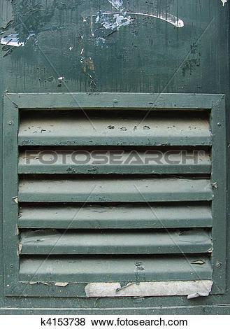 Pictures of green metal grunge door with ventilation grid shaft.