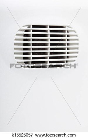 Picture of plastic air vent in white wall ventilation grille.