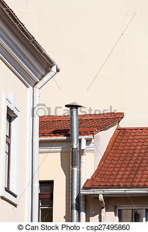 Stock Image of Gutters and ventilation pipe.