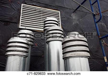 Stock Photo of Stainless steel roof vent pipes c71.
