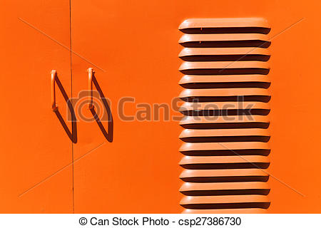 Stock Photos of Iron painted door handles and ventilation slots.