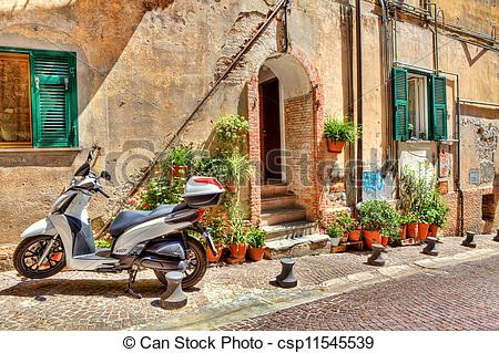 Stock Photos of Motorcycle on cobbled street in Ventimiglia, Italy.