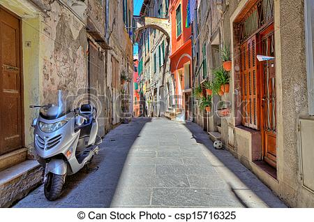 Stock Photo of Scooter on narrow street in Ventimiglia, Italy.