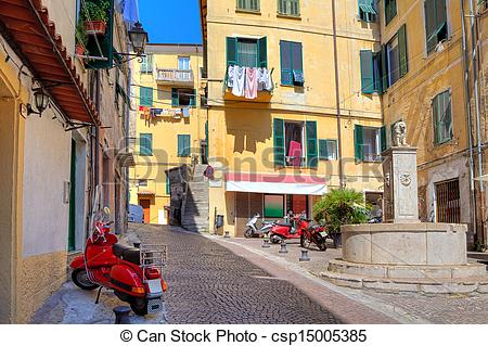 Pictures of Small plaza among colorful houses in Ventimiglia.