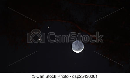 Stock Image of Slender crescent moon with Venus and Jupiter in the.