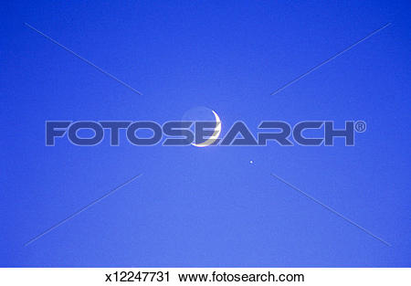 Stock Photography of Crescent Moon and Venus x12247731.
