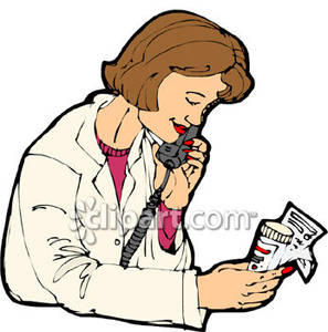 Pharmacist Verifying A Prescription.