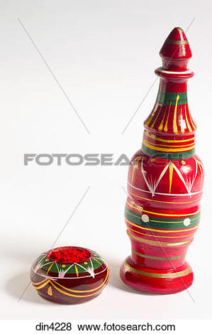 Pictures of Red sindoor or kumkum or vermillion powder in wooden.