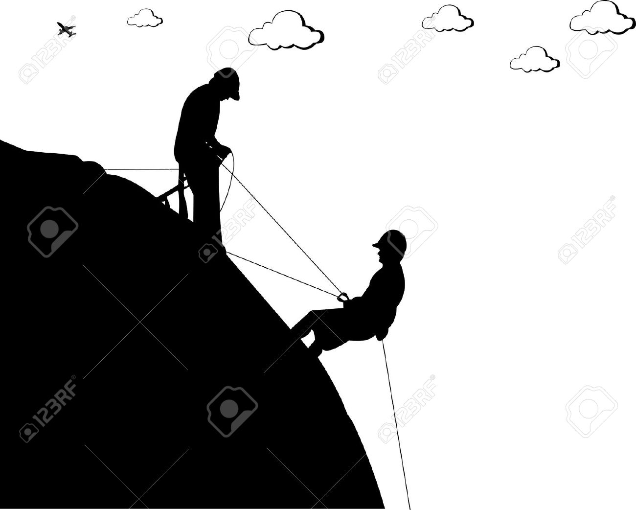 Silhouette Of A Rock With Climbers, Climbing To The Goal Royalty.