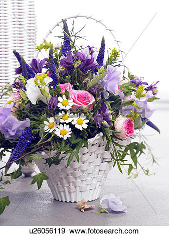 Stock Photograph of Basket with roses, vetches, veronica.