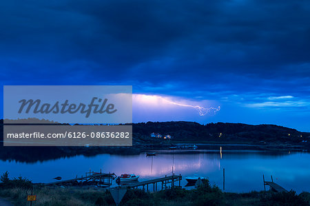 Person in a boat in a storm Stock Photos.