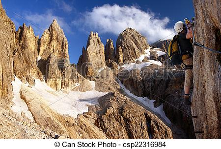 Pictures of climber on via ferrata or klettersteig in Italy or.