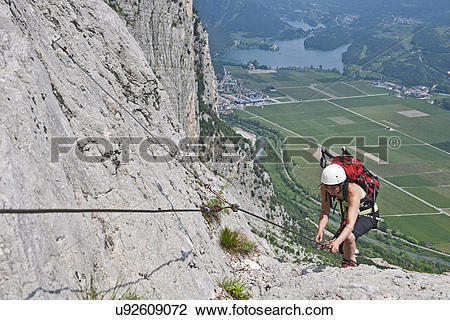 Stock Photo of Female climber on via ferrata Che Guevara, Monte.