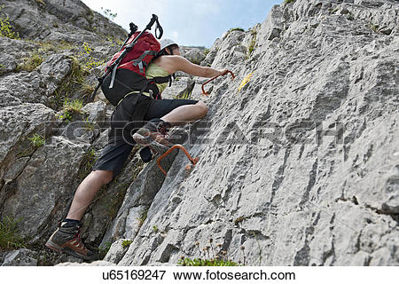 Picture of Femal climber on via ferrata Che Guevara with fixed.