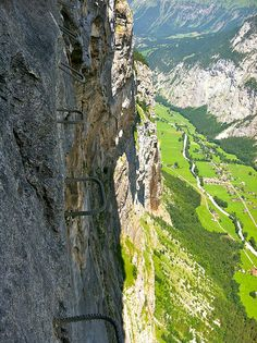 Climbing the via ferrata to Trolltunga, Hardangerfjord, Norway. By.