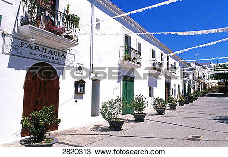 Stock Photo of Potted plants in front of houses, Sant Vicent de Sa.