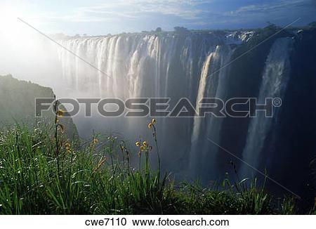 Stock Photography of Sun rising through mist over Zambezi River.