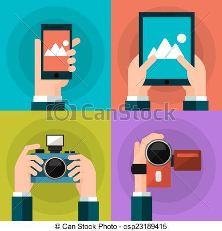 Vector Clip Art of Set of hands holding smart phone, tablet, video.