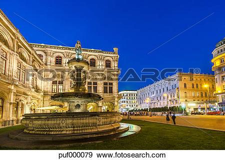 Stock Photograph of Austria, Vienna, fountain at opera square at.