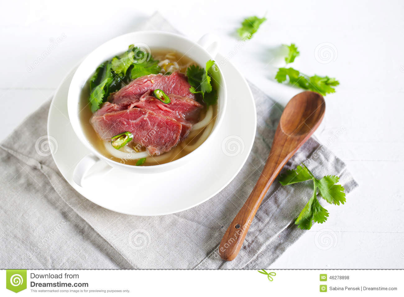 Beef Soup From Vietnam, Pho, Raw Meat Garnished With Coriander And.