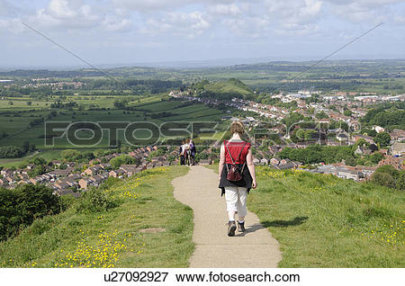 Picture of England, Somerset, Glastonbury. Walkers on a path.