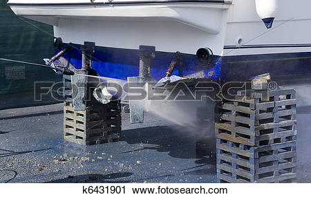 Stock Photography of Boat hull cleaning water pressure washer.