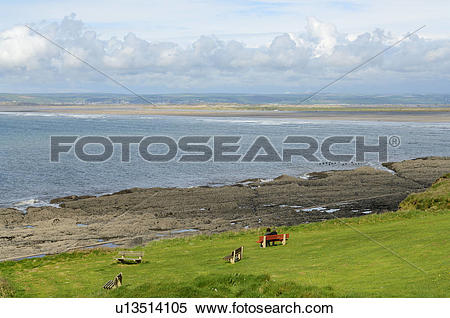 Stock Image of England, Devon, Westward Ho!. A couple relaxing on.