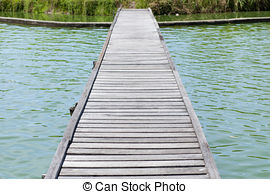 Picture of Wood bridge over water to forest perspective view.