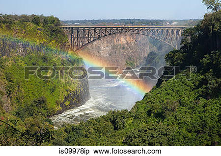 Stock Image of Rainbow over the Zambezi River and Victoria Falls.