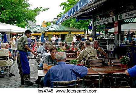 Pictures of STREET CAFE VIKTUALIENMARKT FOOD MARKET MUNICH BAVARIA.