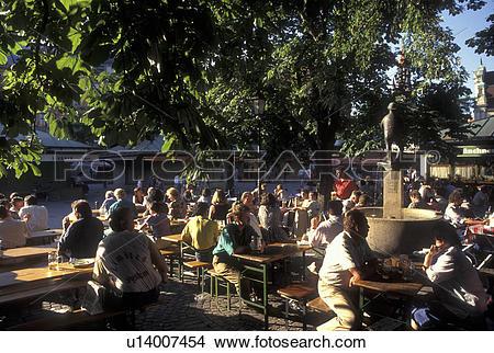 Stock Photo of Munich, beer garden, Germany, Viktualienmarkt.