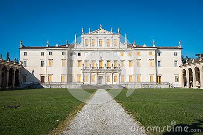 Facade Of Villa With Four Massive Columns Stock Photo.