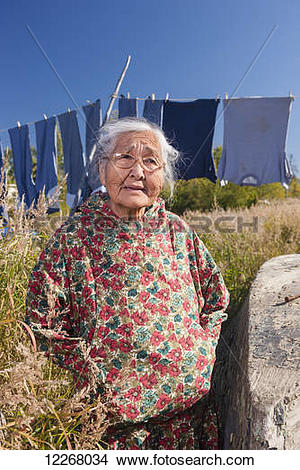 Stock Photo of Female Alaskan native elder wearing a kuspuk posed.