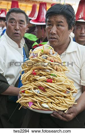 Stock Photo of Village elders bring food offerings at shaman.