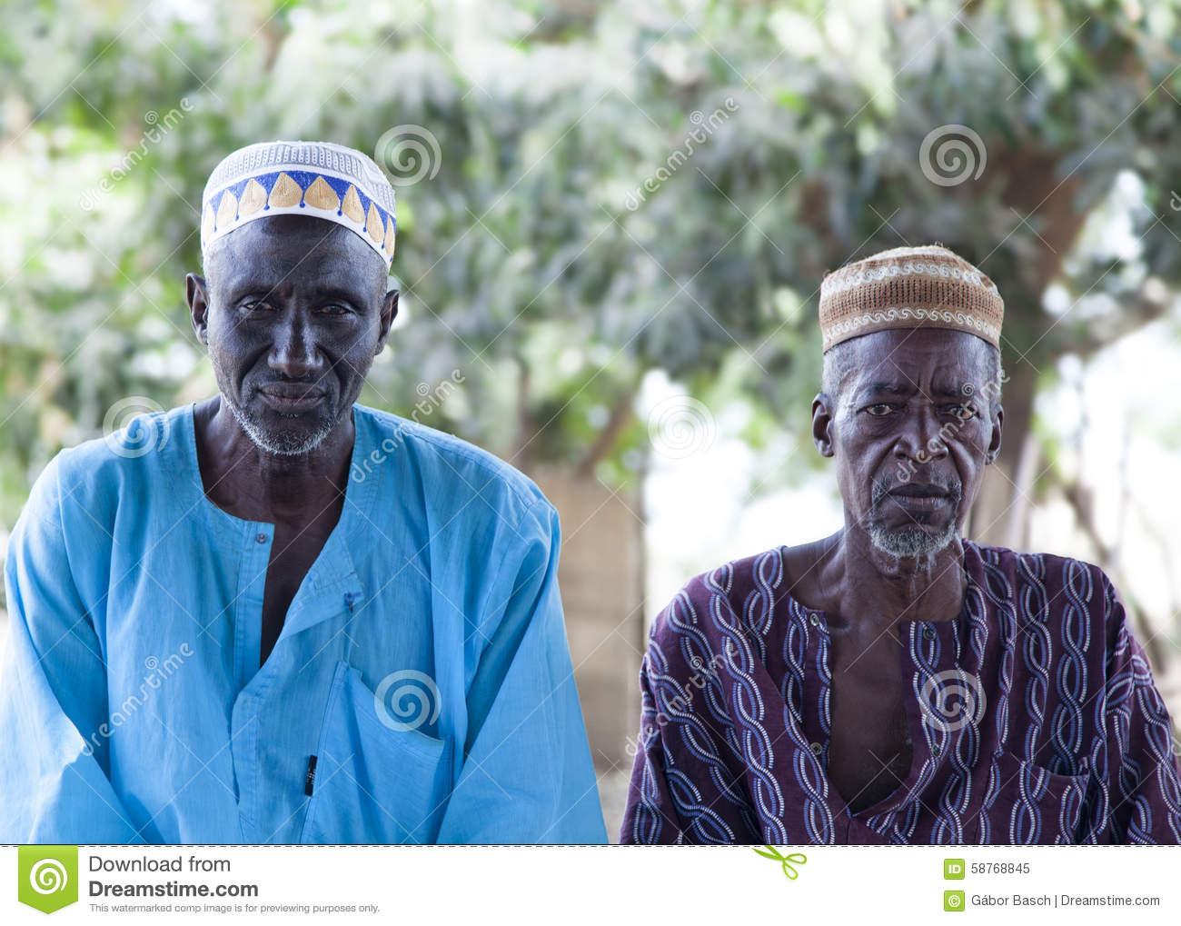 African Village Elders In Traditional Colorful Clothes And Muslim.